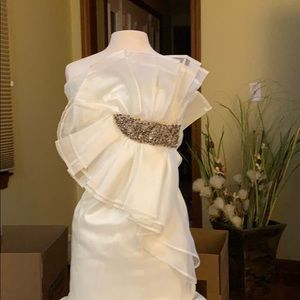 Cream colored gown by Aria